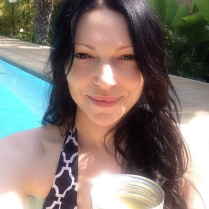 Laura Prepon takes a dip in the pool.
