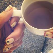 Catt Sadler winds down with some tea.